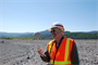 Corps engineer Jim Stengel tosses a piece of pumice in the air during a visit to Mount St. Helens, Wash.  Pumice is a lightweight volcanic rock.