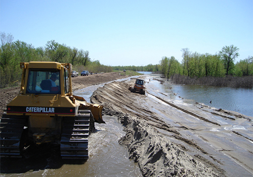 Image of levee construction related to PL 84-99